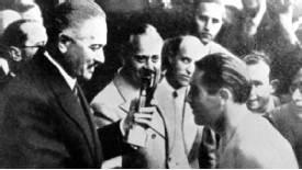 Giuseppe Meazza receives the Jules Rimet trophy after the 1938 success