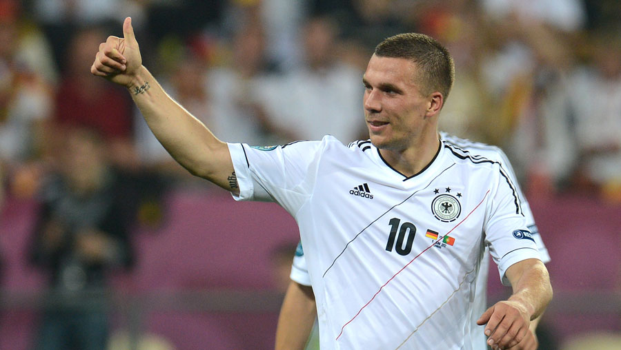 Lukas Podolski celebrates during Germany's win over Portugal