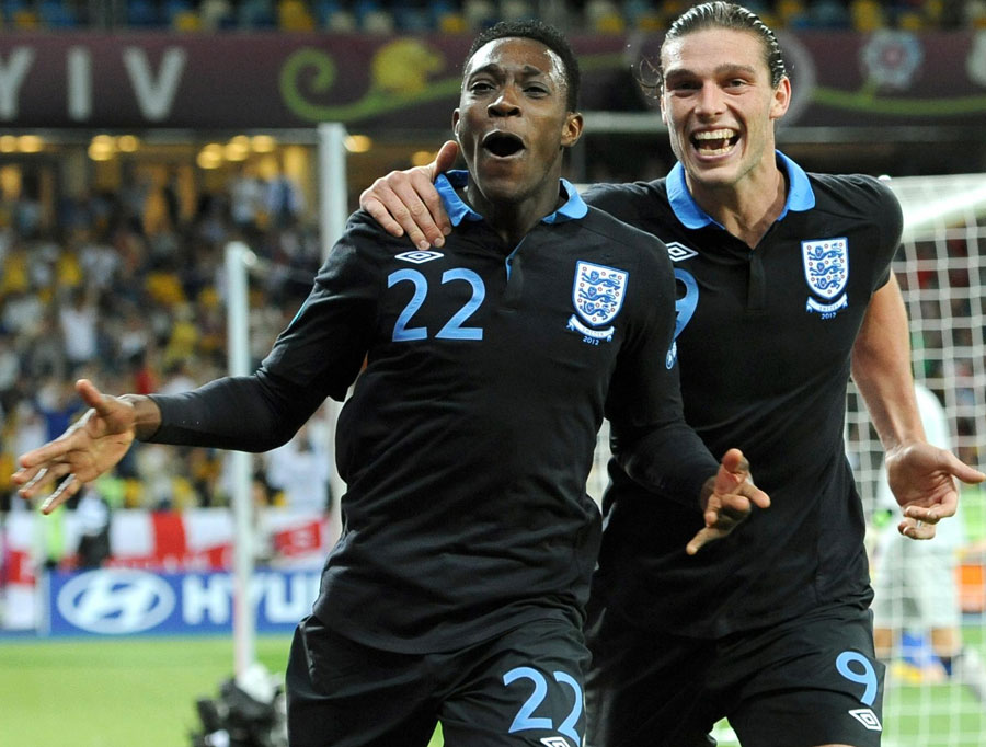 Danny Welbeck and Andy Carroll celebrate the winner