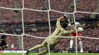 Poland's Robert Lewandowski scores a goal against Greece goalkeeper Costas Chalkias during the Euro 2012 soccer championship Group A match between Poland and Greece in Warsaw, Poland, Friday, June 8, 2012