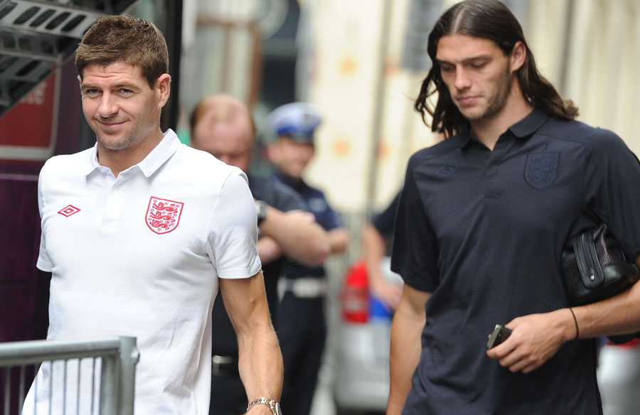 Steven Gerrard and Andy Carroll leave their team hotel for a training session