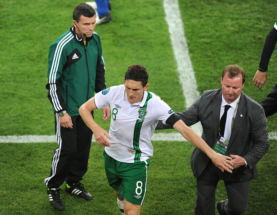 Republic of Ireland's Keith Andrews leaves the field of play after being shown a red card