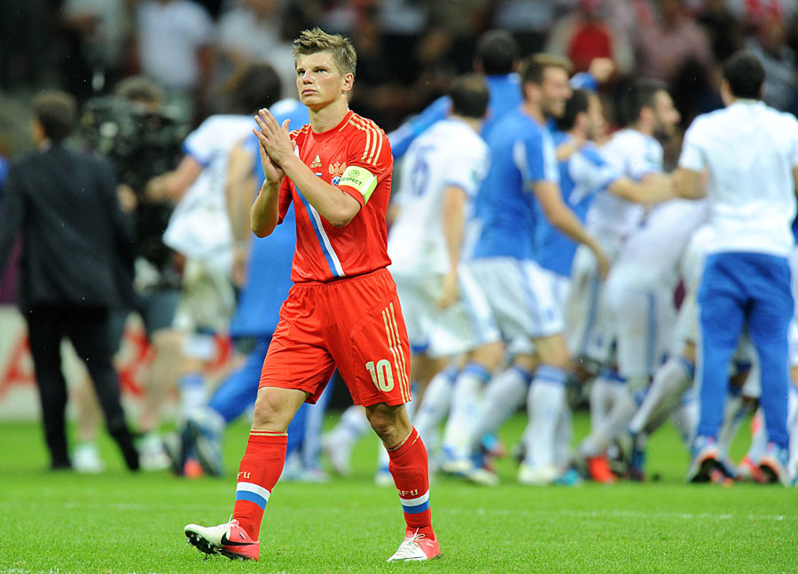 Russia's Andrey Arshavin applauds the Russian fans as he leaves the field of play dejected after the final whistle