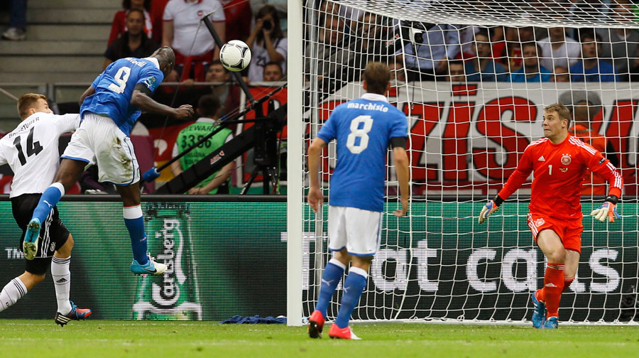 Italy's Mario Balotelli scores after a cross from Antonio Cassano