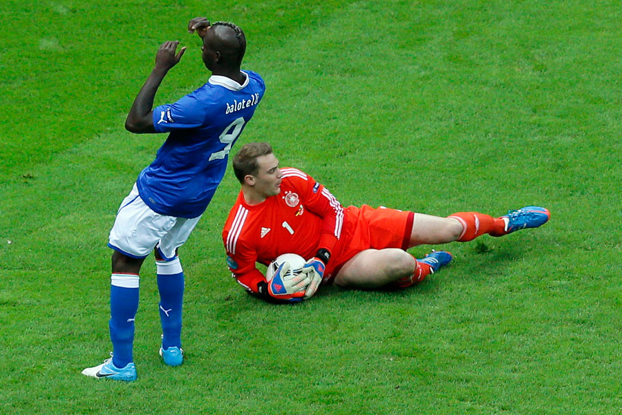 Italy's Mario Balotelli reacts as Germany goalkeeper Manuel Neuer makes a save