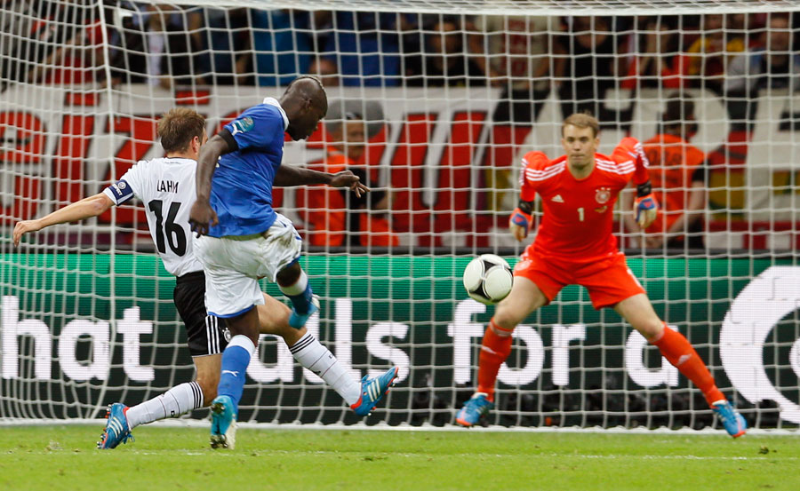 Italy's Mario Balotelli scores his side's second goal