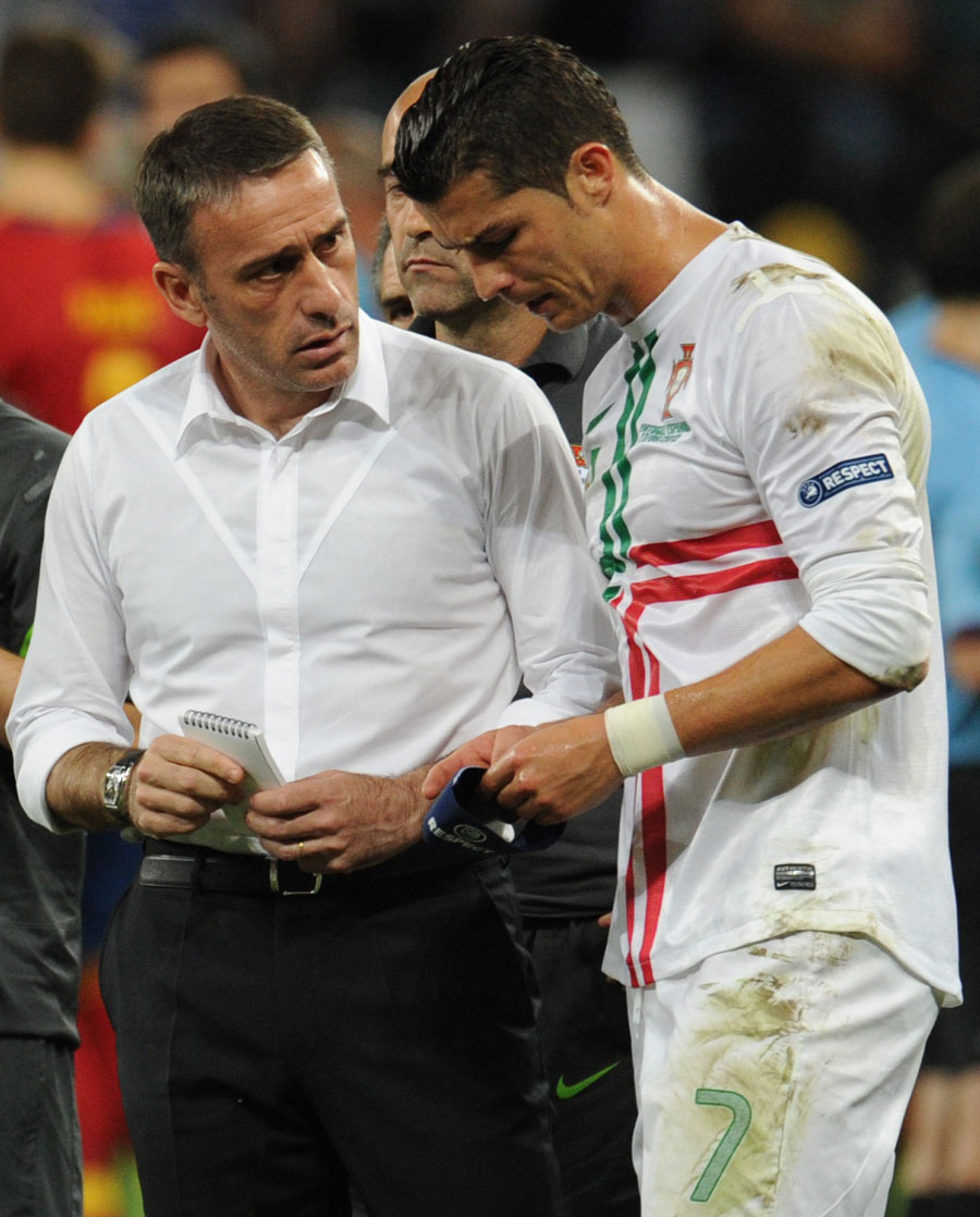 Portugal's head coach Paulo Bento talks to Cristiano Ronaldo
