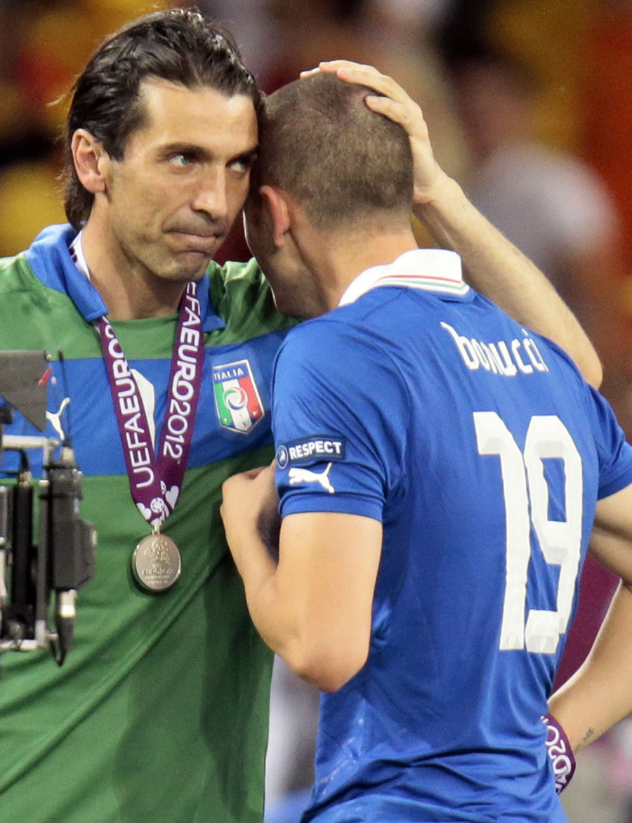 Gianluigi Buffon consoles Leonardo Bonucci after receiving their runners-up medals