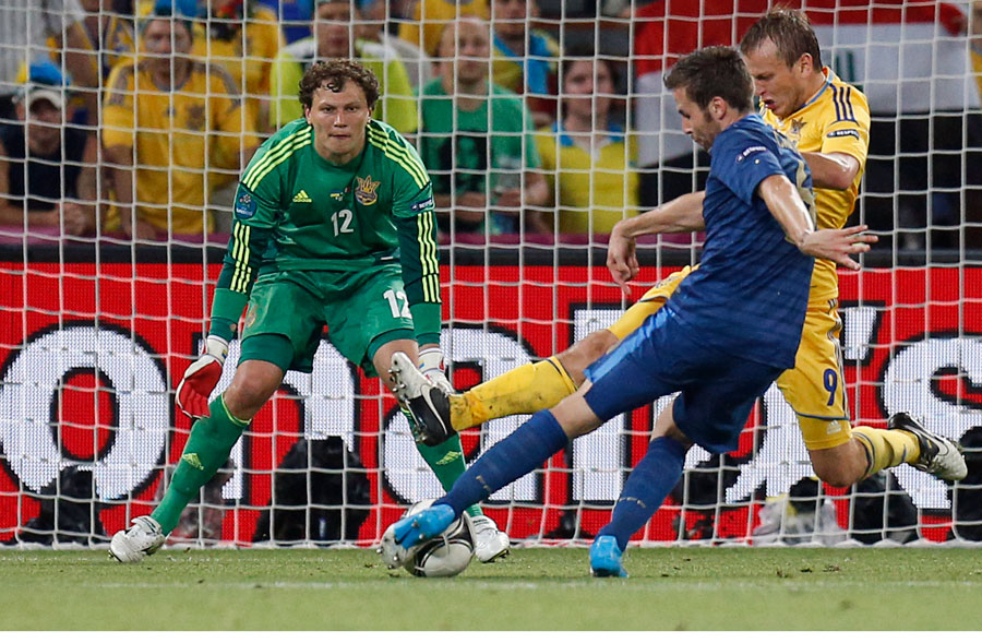 France's Yohan Cabaye scores his team's second goal past Ukraine goalkeeper Andriy Pyatov and Oleh Gusev