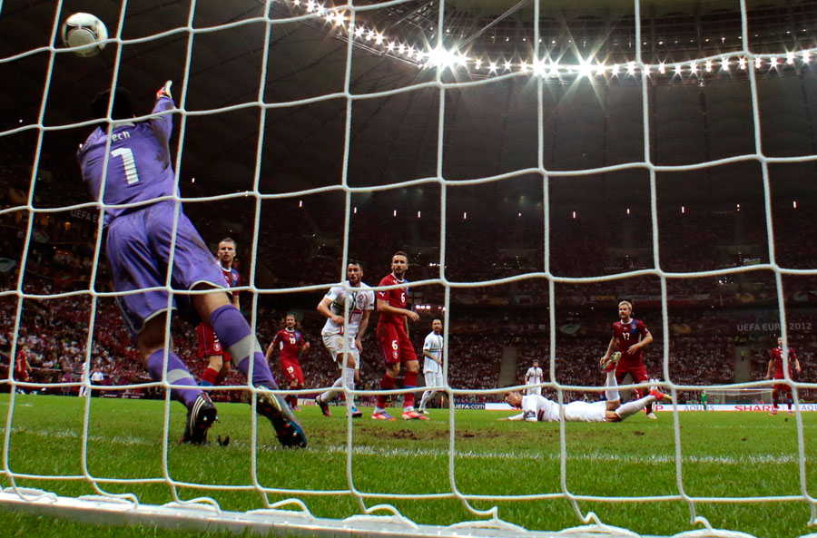 Portugal's Cristiano Ronaldo scores with a header past Petr Cech