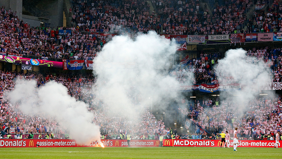 Smoke from flares spreads through the stadium during Italy versus Croatia