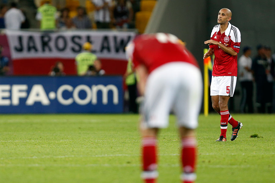 Denmark's players react after they crashed out of Euro 2012