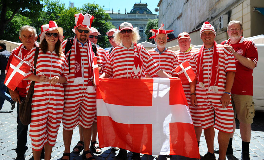 Fans of Denmark walk through the historic part of Lviv