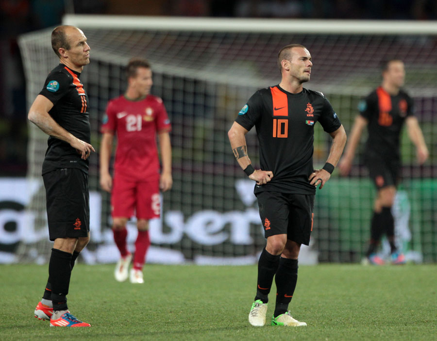 Netherlands' Arjen Robben and Wesley Sneijder appear dejected at the end of the game
