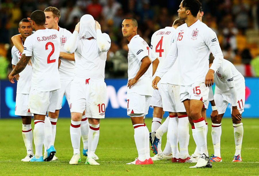 Players of England look dejected after the penalty shootout
