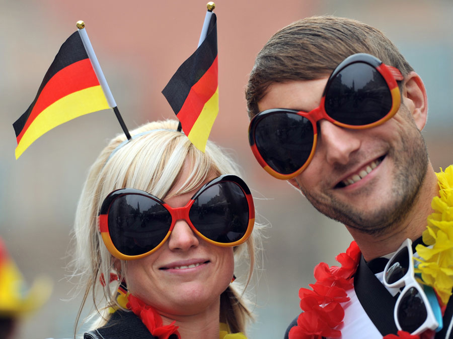 Supporters of Germany wear funny sunglasses in the streets ahead of the match 20120622