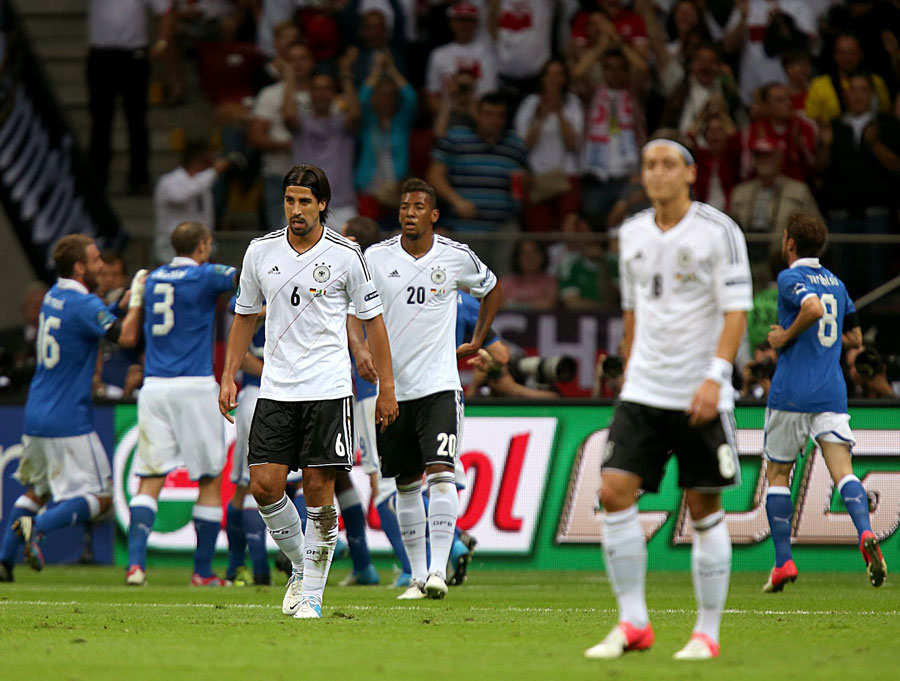 Germany's players react after Mario Balotelli put Italy ahead