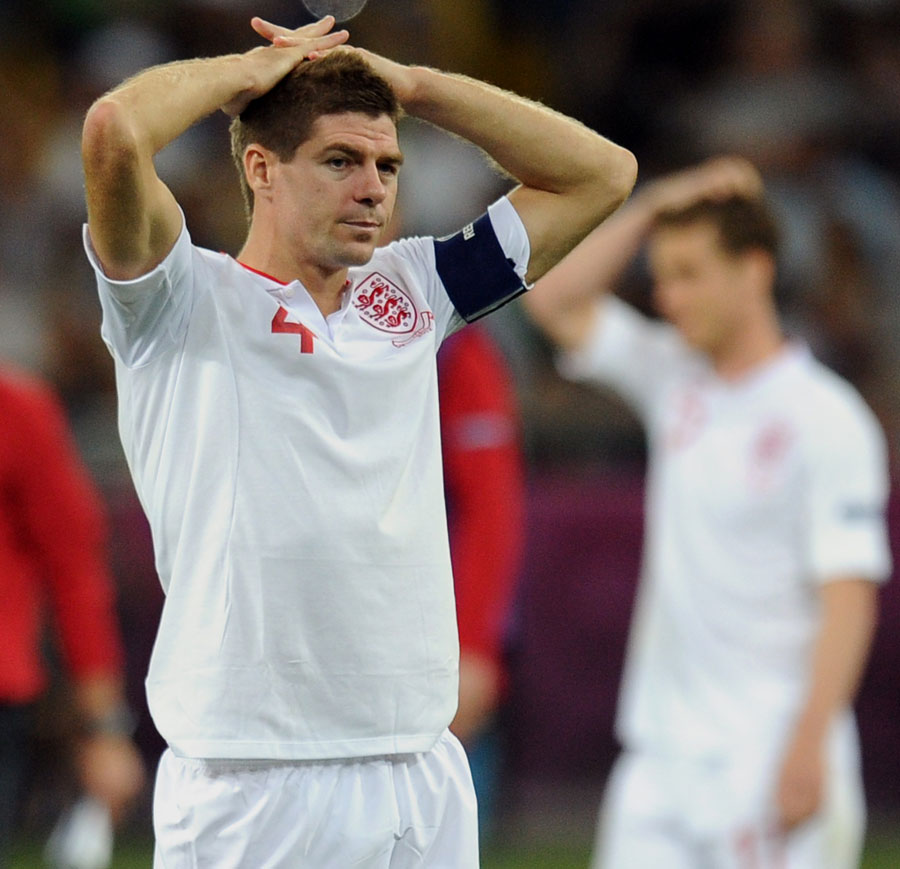 Steven Gerrard consoles Ashley Cole after England's defeat to Italy