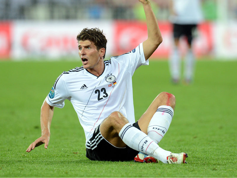 Mario Gomez scores for Germany against Portugal