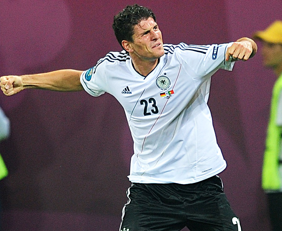 Mario Gomez celebrates scoring a goal for Germany against Portugal 100612