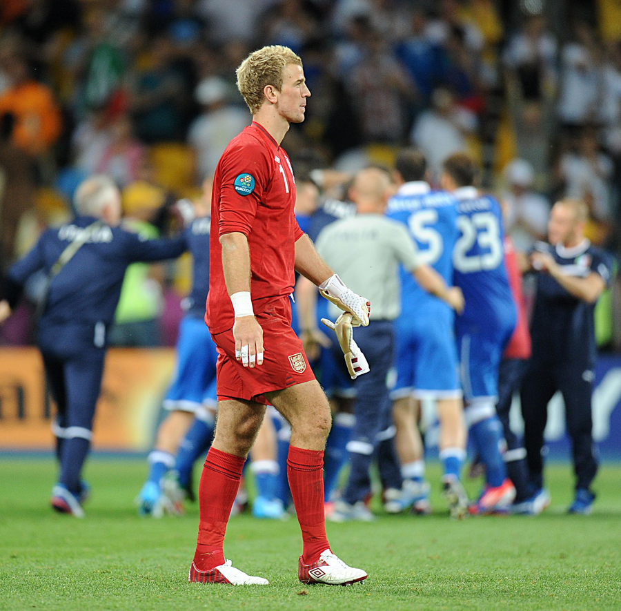 Joe Hart trudges off disconsolately after the penalty defeat to Italy