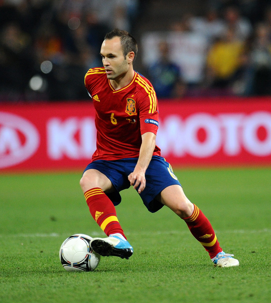 Andres Iniesta controls the ball