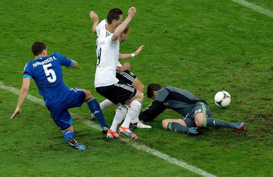 Germany's Miroslav Klose and Andre Schurrle score a disallowed goal past Greece goalkeeper Michalis Sifakis