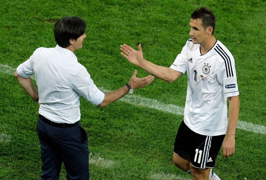 Germany's Miroslav Klose is congratuled by head coach Joachim Low after being substituted