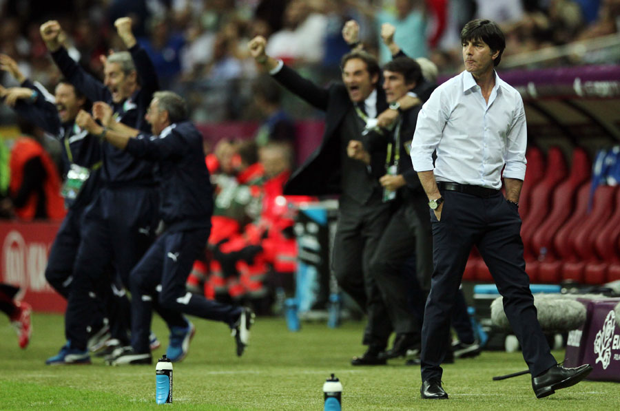 Germany's head coach Joachim Low looks on after Italy scored