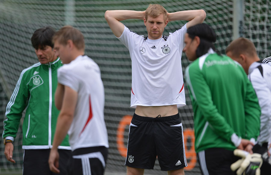 Per Mertesacker takes part in Germany's training session