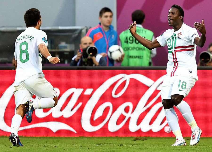 Joao Moutinho celebrates a goal with Silvestre Varela against Denmark