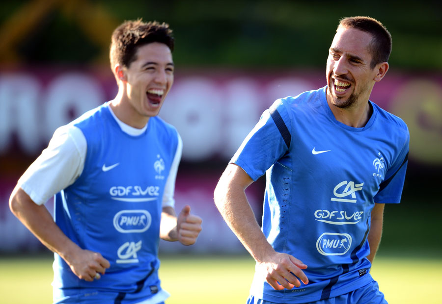 Samir Nasri and Franck Ribery take part in a training session