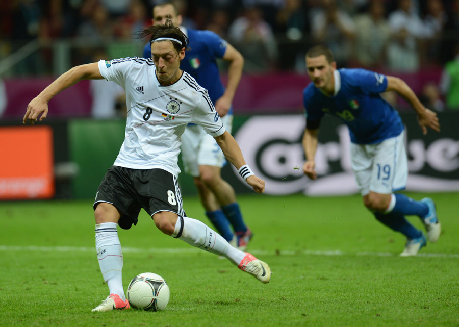 German midfielder Mesut Ozil scores a penalty late on, but it was too late