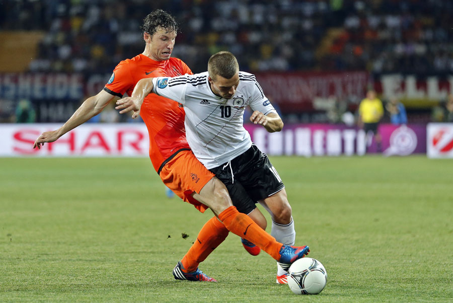 Mark van Bommel tackles Lukas Podolski