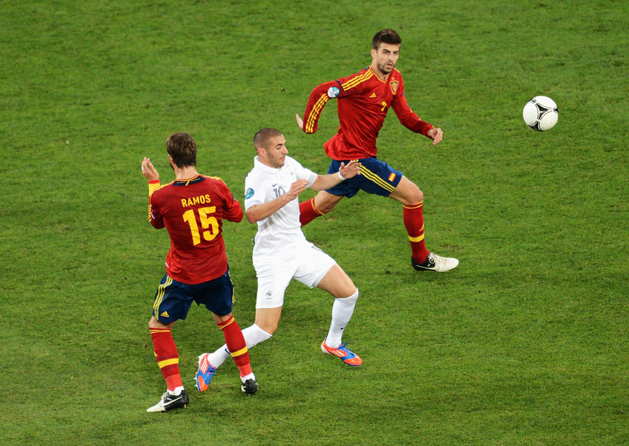 Sergio Ramos and Gerard Pique close in on Karim Benzema