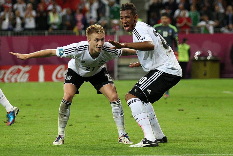 Germany's Marco Reus celebrates scoring his side's fourth goal with Jerome Boateng