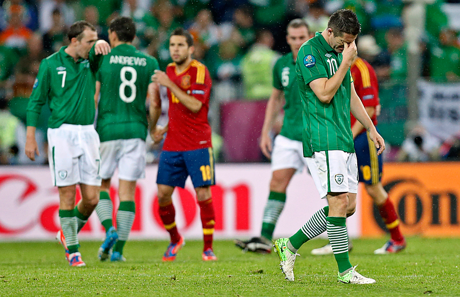 Ireland's Robbie Keane leaves the pitch dejected following defeat to Spain