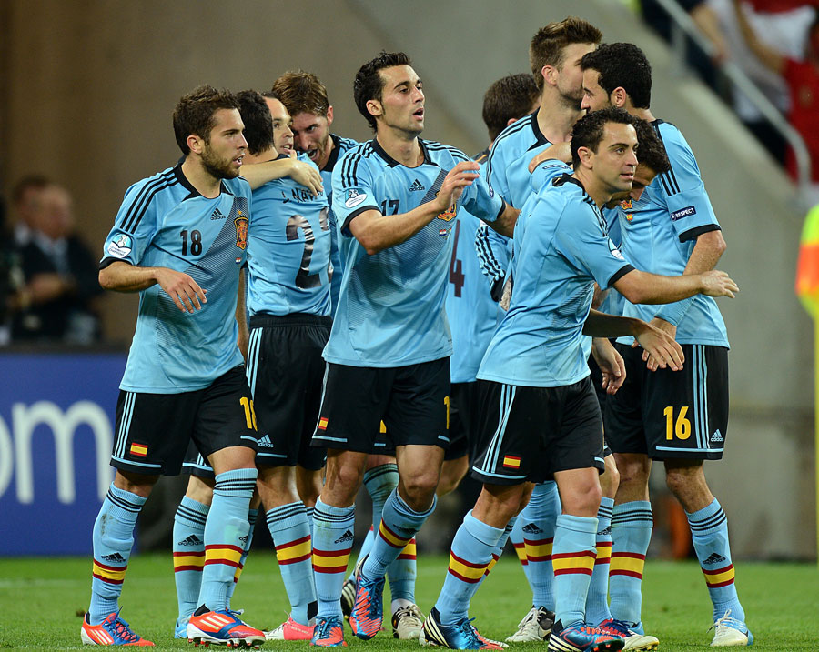 Spain players celebrate after Jesus Navas scores their side's winner,