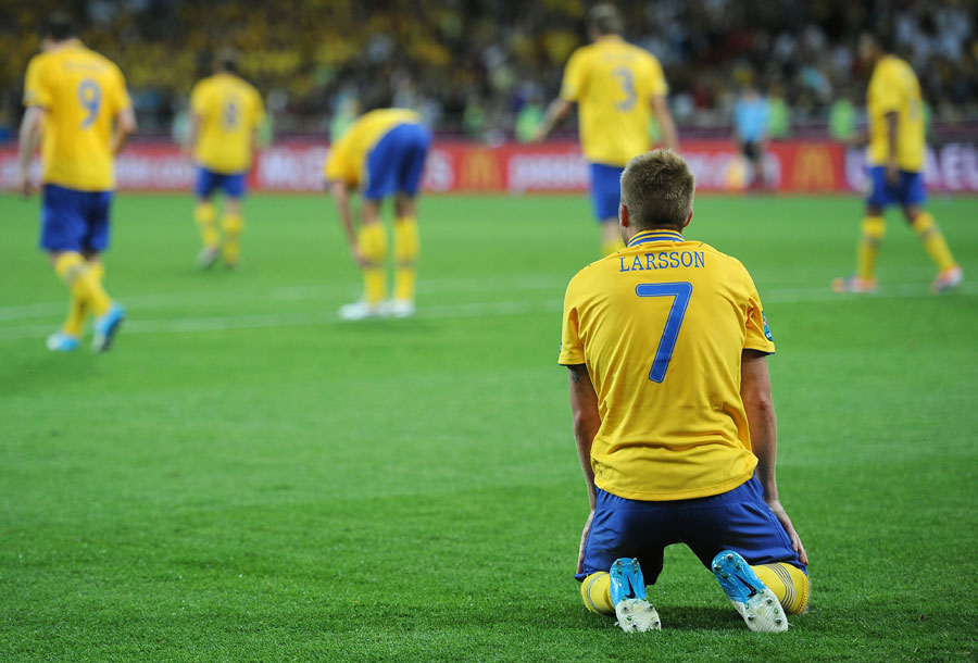 Sebastian Larsson of Sweden sits dejected after they were knocked out