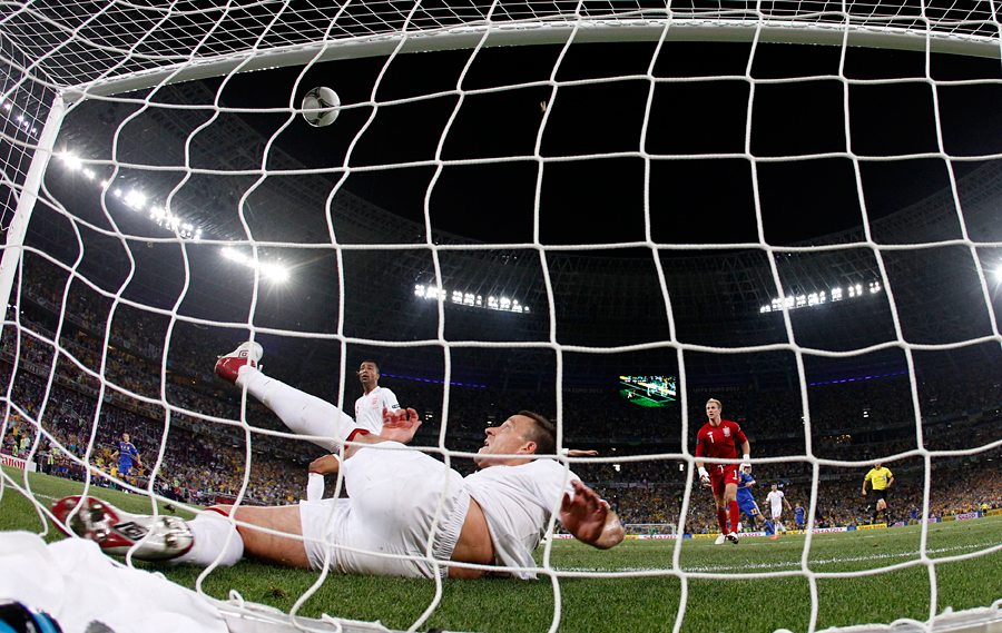 England's John Terry clears the ball off the line against Ukraine