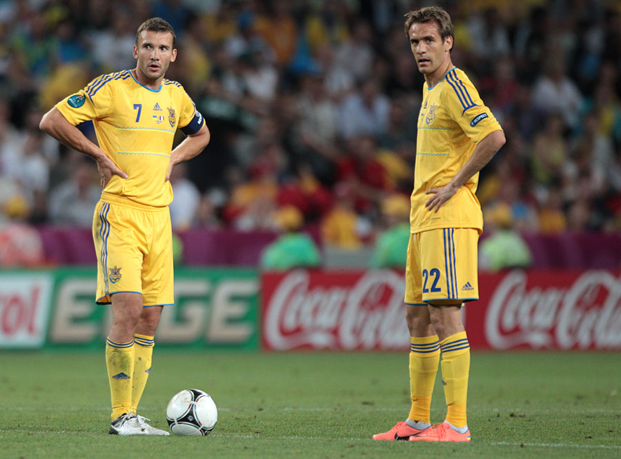 Ukraine's Andriy Shevchenko and Marko Devic wait to restart the game after conceding their first goal