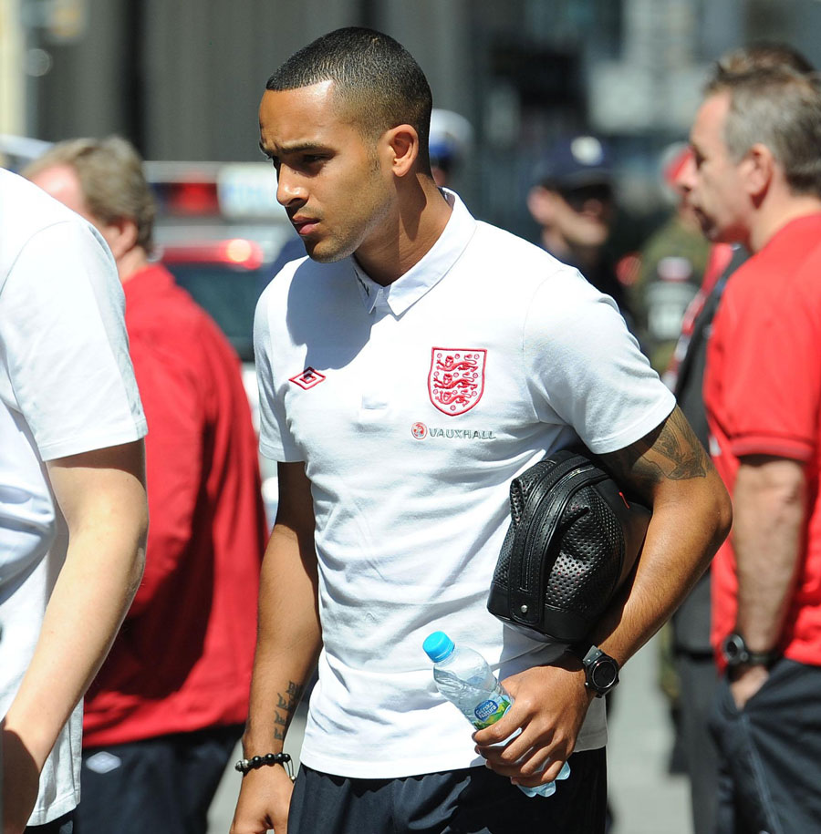 Theo Walcott leaves the team hotel for a training session