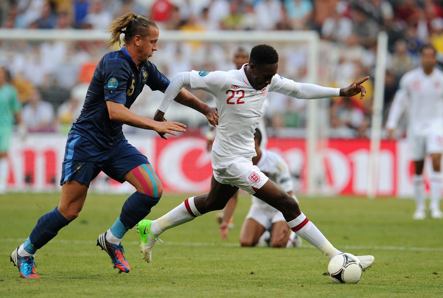 Danny Welbeck strides away from Philippe Mexes