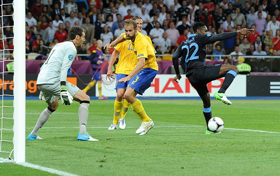 England's Danny Welbeck flicks the ball home and scores their third goal of the game