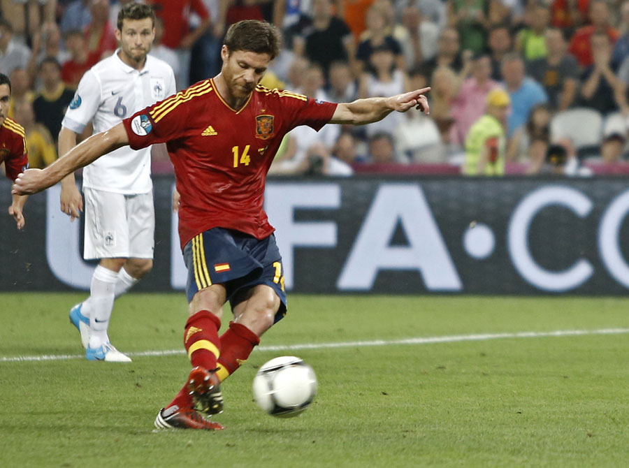 Spain's Xabi Alonso scores a penalty kick for his side's second goal