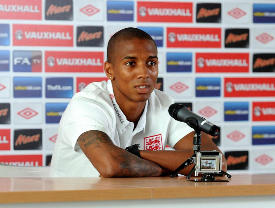 Ashley Young talks during a press conference